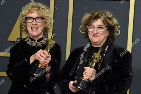 """Nancy Haigh, Barbara Ling. Nancy Haigh, left, and Barbara Ling, winners of the award for best production design for """"Once Upon a Time in Hollywood"""", pose in the press room at the Oscars, at the Dolby Theatre in Los Angeles"""