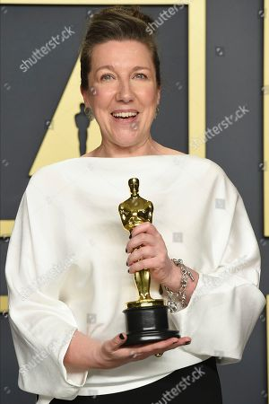 """Jacqueline Durran, winner of the award for best costume design for """"Little Women"""", poses in the press room at the Oscars, at the Dolby Theatre in Los Angeles"""