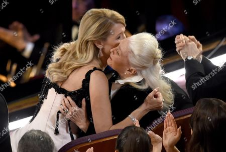 "Laura Dern, Diane Ladd. Laura Dern, left, is congratulated by Diane Ladd before going on stage to accept the award for best performance by an actress in a supporting role for ""Marriage Story"" at the Oscars, at the Dolby Theatre in Los Angeles"