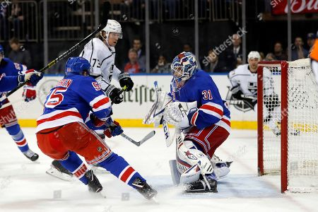 New York Rangers goaltender Igor Shesterkin (31) makes a save in front of Los Angeles Kings right wing Tyler Toffoli (73) in the first period of an NHL hockey game, in New York