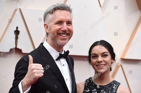 Matthew Wood, left, arrives at the Oscars, at the Dolby Theatre in Los Angeles