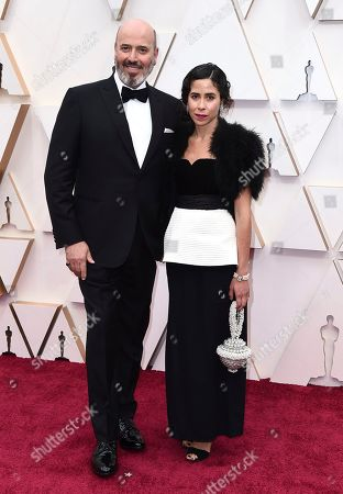 Mark Bridges, left, arrives at the Oscars, at the Dolby Theatre in Los Angeles