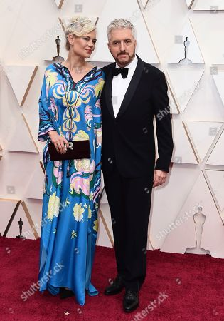 Stock Photo of Eva Maywald, Anthony McCarten. Anthony McCarten, right, and Eva Maywald arrive at the Oscars, at the Dolby Theatre in Los Angeles