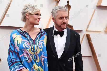 Stock Picture of Eva Maywald, Anthony McCarten. Anthony McCarten, right, and Eva Maywald arrive at the Oscars, at the Dolby Theatre in Los Angeles