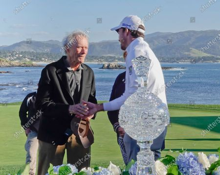 Winner Nick Taylor gets congrats from Clint Eastwood Boss of the Monterey peninsular Foundation after winning the AT&T Pro-Am PGA Golf event