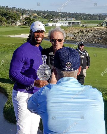 Stock Photo of Kevin Streelman takes iPhone picture of his partner Larry Fitzgerald and Clint Eastwood after winning the amateur team trophy