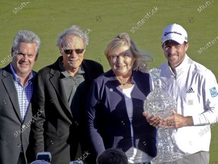 Stock Picture of Winner Nick Taylor poses with Clint Eastwood AT&T CEO; Stev John, boss of the event, and Clint Eastwood on the 18th