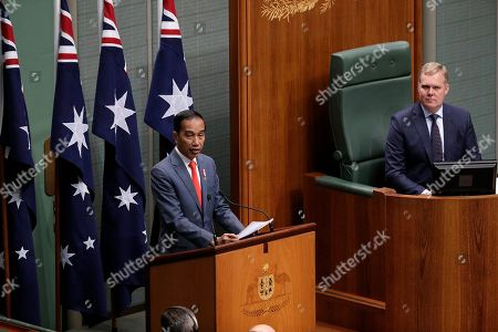 Stock Image of Indonesia's President Joko Widodo, left, address the Australian Parliament in Canberra, as the speaker of the house, Tony Smith, right, listens . Widodo is on a two-day visit to Canberra, his fourth visit to Australia