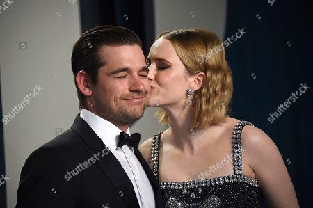 Stock Image of Rachel Brosnahan, Jason Ralph. Rachel Brosnahan, right, kisses Jason Ralph as they arrive at the Vanity Fair Oscar Party, in Beverly Hills, Calif