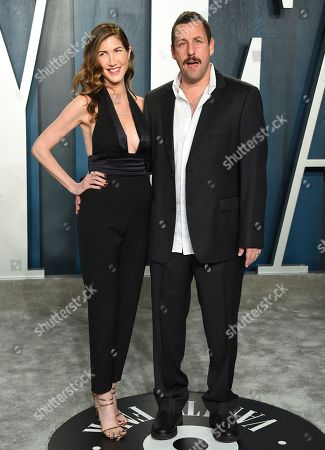 Jackie Sandler, Adam Sandler. Jackie Sandler, left, and Adam Sandler arrive at the Vanity Fair Oscar Party, in Beverly Hills, Calif