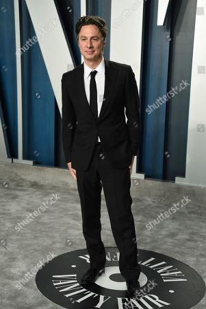 Zach Braff arrives at the Vanity Fair Oscar Party, in Beverly Hills, Calif