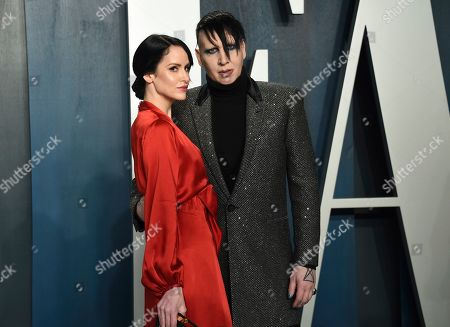 Lindsay Usich, Marilyn Manson. Lindsay Usich, left, and Marilyn Manson arrive at the Vanity Fair Oscar Party, in Beverly Hills, Calif