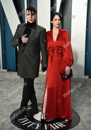 Lindsay Usich, right, and Marilyn Manson arrive at the Vanity Fair Oscar Party, in Beverly Hills, Calif