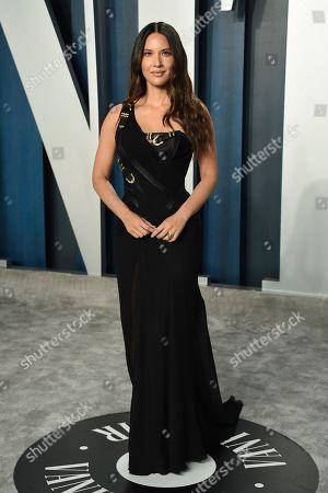 Olivia Munn arrives at the Vanity Fair Oscar Party, in Beverly Hills, Calif
