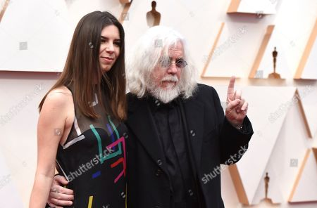 Robert Richardson, right, arrives at the Oscars, at the Dolby Theatre in Los Angeles