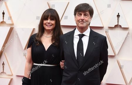 Ann Marie Zirbes, Thomas Newman. Ann Marie Zirbes, left, and Thomas Newman arrive at the Oscars, at the Dolby Theatre in Los Angeles
