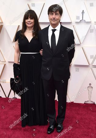 Stock Picture of Ann Marie Zirbes, Thomas Newman. Ann Marie Zirbes, left, and Thomas Newman arrive at the Oscars, at the Dolby Theatre in Los Angeles