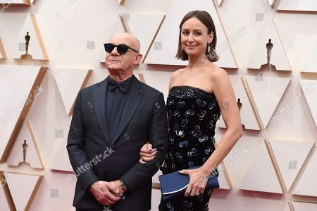 Bernie Taupin, Heather Lynn Hodgins Kidd. Bernie Taupin, left, and Heather Lynn Hodgins Kidd arrive at the Oscars, at the Dolby Theatre in Los Angeles