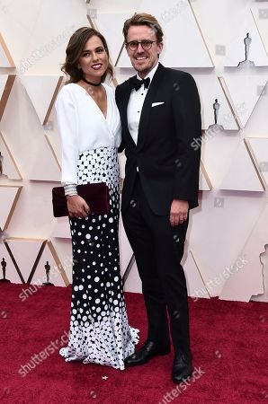 Andrew R. Jones, right, arrives at the Oscars, at the Dolby Theatre in Los Angeles