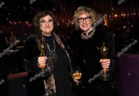 """Barbara Ling, Nancy Haigh. Barbara Ling, left, and Nancy Haigh, winners of the award for best production design for """"Once Upon a Time in Hollywood"""", attend the Governors Ball after the Oscars, at the Dolby Theatre in Los Angeles"""