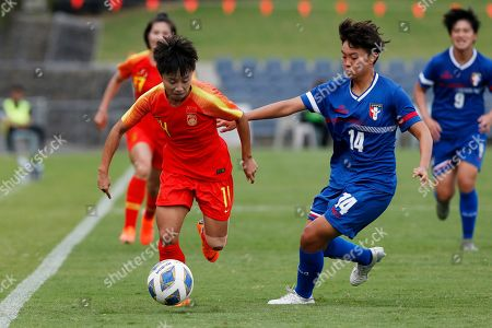 Zhang Linyan, left, of China challenges for the ball against Taiwan's Lan Yu-Chieh during their Olympic soccer qualifying match in Sydney