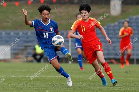 Wang Shanshan, Lan Yu-Chieh. Taiwan's Lan Yu-Chieh, left, defends the ball against China's Wang Shanshan during their Olympic soccer qualifying match in Sydney
