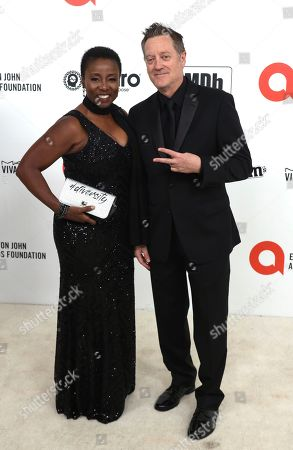 Stock Image of Kirk Bovill, Joni Bovill. Kirk Bovill, left, and Joni Bovill arrive at the 2020 Elton John AIDS Foundation Oscar Viewing Party, in West Hollywood, Calif