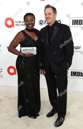 Kirk Bovill, Joni Bovill. Kirk Bovill, left, and Joni Bovill arrive at the 2020 Elton John AIDS Foundation Oscar Viewing Party, in West Hollywood, Calif