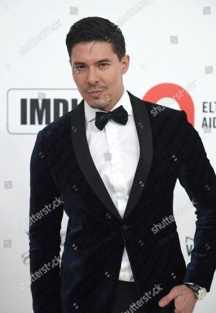 Lewis Tan arrives at the 2020 Elton John AIDS Foundation Oscar Viewing Party, in West Hollywood, Calif