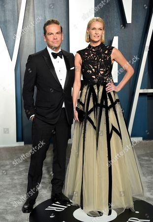Lachlan Murdoch and Sarah Murdoch Fox Corporation CEO Lachlan Murdoch and left and and wife Sarah Murdoch arrive at the Vanity Fair Oscar Party and in Beverly Hills, Calif