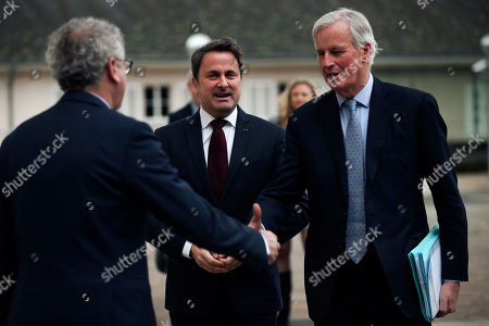 Michel Barnier, Xavier Bettel, Pierre Gramegna. European Commission's Head of Task Force for Relations with the United Kingdom Michel Barnier, right, shakes hands with Luxembourg's Finance Minister Pierre Gramegna, left, next to Luxembourg's Prime Minister Xavier Bettel before their meeting in Luxembourg, . Earlier on Monday Barnier met Scotland's First Minister Nicola Sturgeon in Brussels