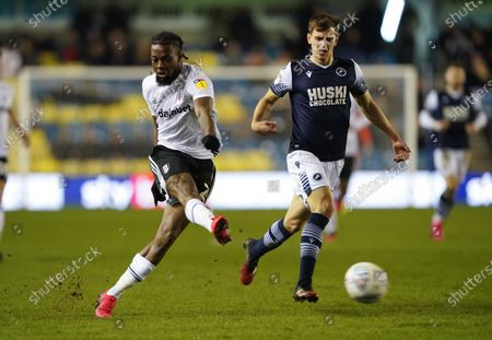 Josh Onomah of Fulham gets a shot on goal past Murray Wallace of Millwall