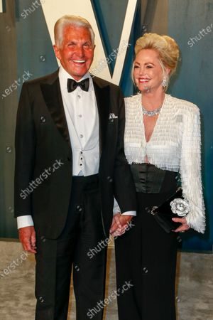 Stock Photo of George Hamilton and Barbara Sturm attend the 2020 Vanity Fair Oscar Party following the 92nd annual Academy Awards ceremony in Beverly Hills, California, USA, 09 February 2020 (Issued 10 February 2020).