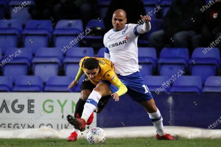 Jake Caprice of Tranmere Rovers and Jayden Mitchell-Lawson of Bristol Rovers