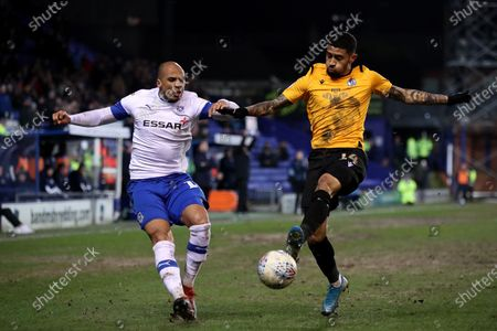 Jake Caprice of Tranmere Rovers and Josh Ginnelly of Bristol Rovers