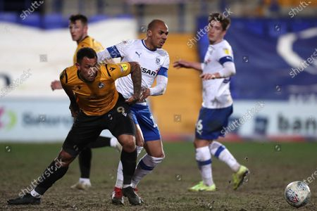 Jake Caprice of Tranmere Rovers and Jonson Clarke-Harris of Bristol Rovers players get involved in a tussle