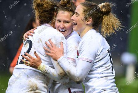 Scotland Women vs England Women. England's Emily Scott celebrates scoring a try with teammates