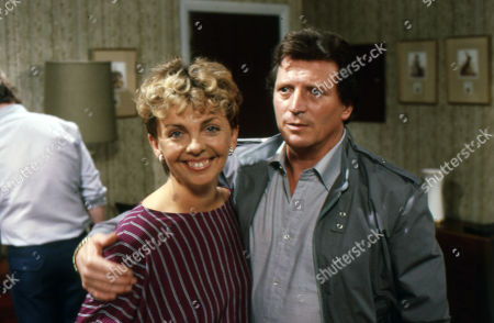 Stock Picture of Maggie Dunlop tells Mike she is pregnant. Jill Kerman (as Maggie Dunlop) and Johnny Briggs (as Mike Baldwin)
