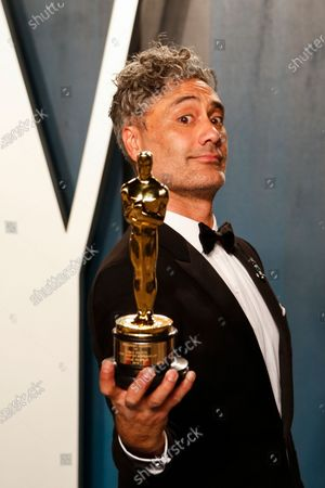 Stock Picture of Taika Waititi attends the 2020 Vanity Fair Oscar Party following the 92nd annual Academy Awards ceremony in Beverly Hills, California, USA, 09 February 2020. The Oscars are presented for outstanding individual or collective efforts in filmmaking in 24 categories.