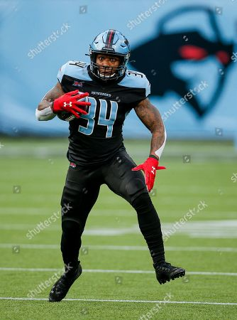 Dallas Renegades running back Cameron Artis-Payne (34) carries the ball during an XFL football game against the St. Louis Battlehawks, in Arlington, Texas. St. Louis won 15-9