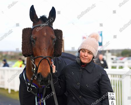 Stock Image of Trainer Laura Morgan with Skipping On in the Parade Ring prior to The Crystal Services Commercial and Domestic Cleaning Chase during Horse Racing at Plumpton Racecourse on 10th February 2020