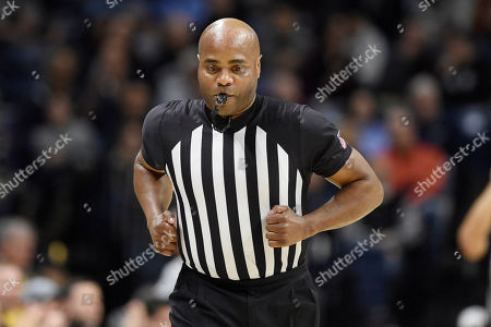 Stock Image of Official Jeff Anderson in the first half of an NCAA college basketball game, in Storrs, Conn
