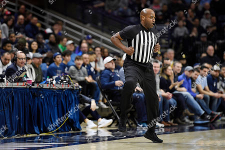 Official Jeff Anderson runs down the court in the first half of an NCAA college basketball game, in Storrs, Conn