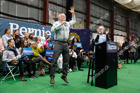 Ben Cohen, Jerry Greenfield. Ben Cohen, center, jumps in the air and is joined by Jerry Greenfield, right, as the Ben & Jerry's co-founders introduce Democratic presidential candidate Sen. Bernie Sanders, I-Vt., at a campaign event in Manchester, N.H