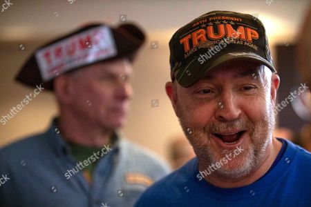 Frank Daswon, Raymond Boyd. Frank Dawson, right, of Woburn, Mass., and Raymond Boyd of Reading, Mass., attend a Cops for Trump rally hosted by Vice President Mike Pence, in Portsmouth, N.H