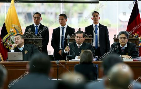 Stock Picture of A criminal court of the National Court of Justice, preceded by the judges Ivan Saquicela (L), Ivan Leon (C) and Marco Rodriguez (R), begins the trial against the Ecuadorian ex-president Correa, and 21 other people, for the 'Bribes' case, in Quito, Ecuador, 10 February 2020. In case of being convicted, with a final judgment, the case would remove former President Rafael Correa from an eventual candidacy for the 2021 elections. The trial is about the so-called 'Bribes 2012-2016' case, which also splashes former vice president Jorge Glas, in prison for illicit association in the bribery plot of the Brazilian firm Odebrecht.