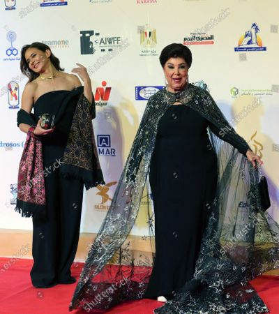 Stock Picture of Egyptian actress Ragaa Al Eddawy (R) and Egyptian actress Nelly Karim arrive for the opening ceremony of the 4th Aswan International Women Film Festival, in Aswan, Egypt, 10 February 2020. The AIWFF runs from 10 to 15 February.