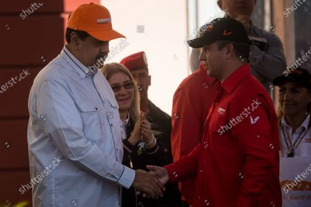The President of Venezuela, Nicolas Maduro (L), along with his wife Cilia Flores (2-L), greets the president of Conviasa, Ramon Celestino Velasquez Araguayan (R), after a march in which sympathizers of the ruling party and workers of the Conviasa airline participate in rejection of the sanctions that the United States imposed on this state company, in Caracas, Venezuela, 10 February 2020. The Venezuelan government announced on 08 February that it will denounce before international instances the recent sanction issued by the Administration of the US President Donald Trump, against its state airline, while calling the measure a 'big mistake' political.