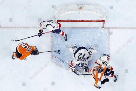 Travis Sanheim, Sergei Bobrovsky. Philadelphia Flyers' Travis Sanheim (6) scores a goal against Florida Panthers' Sergei Bobrovsky (72) and Aaron Ekblad (5) as MacKenzie Weegar (52) and James van Riemsdyk (25) battle for position during the second period of an NHL hockey game, in Philadelphia