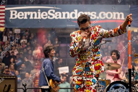 Julian Casablancas, lead singer of The Strokes, performs after Democratic presidential candidate Sen. Bernie Sanders, I-Vt., speaks at a campaign stop at the Whittemore Center Arena at the University of New Hampshire, in Durham, N.H